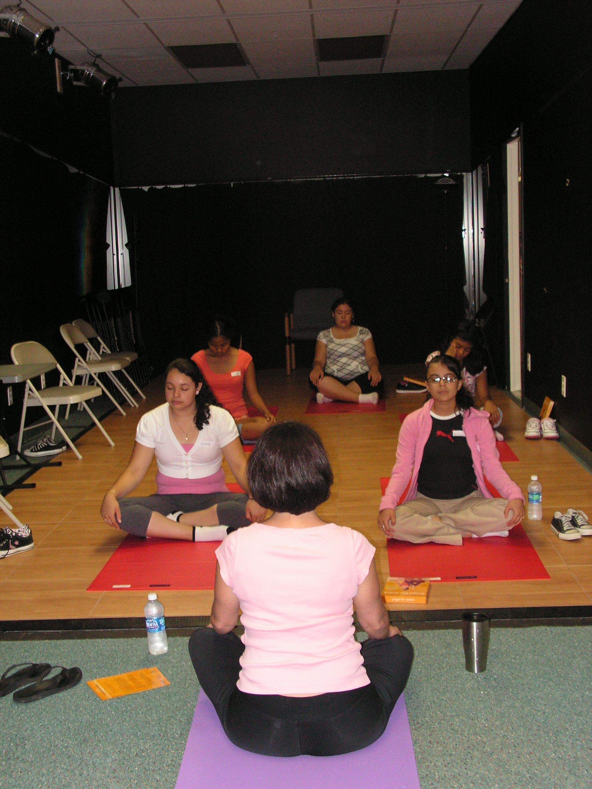 The Circle de Luz girls try yoga at their summer wellness camp.